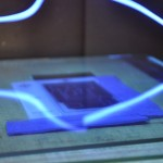 Exposing the board under UV light with the mask pressed flat under glass for 6 minutes.